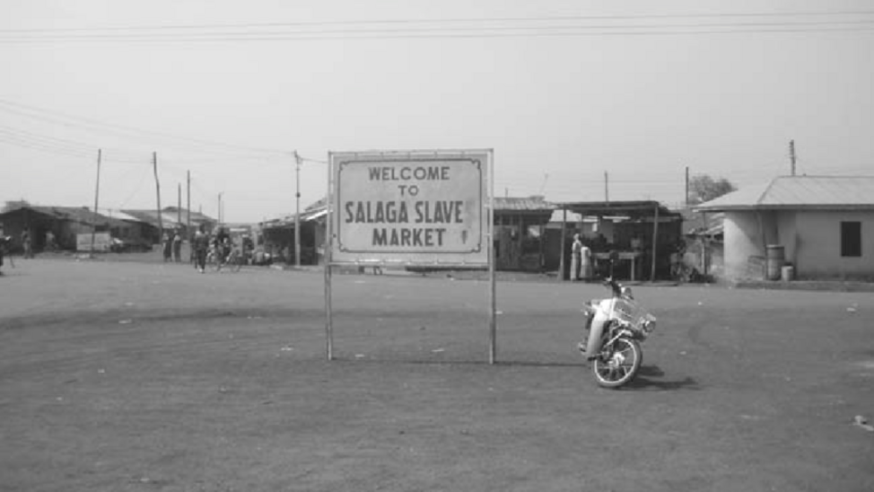 Black and white photograph of sign saying 'Welcome to Salaga Slave Market' © Katharina Schramm